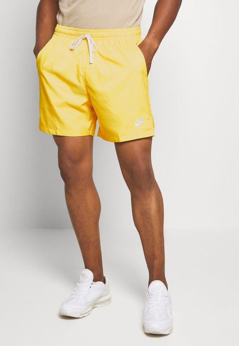 Nike Sportswear - FLOW - Shorts - opti yellow/white