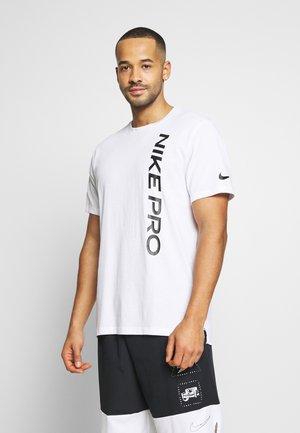 BURNOUT - T-shirt imprimé - white/black
