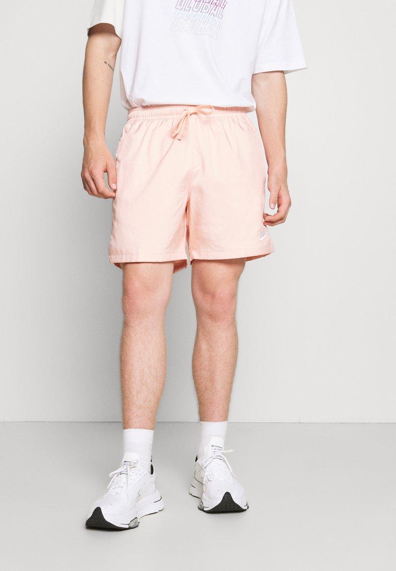 Nike Sportswear - FLOW - Shorts - arctic orange/white