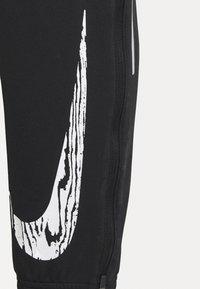 Nike Performance - ESSENTIAL PANT - Pantaloni sportivi - black/reflective silver - 5