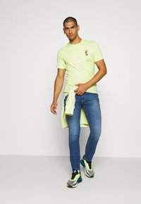 Tommy Jeans - SCANTON - Slim fit jeans - bright blue - 1