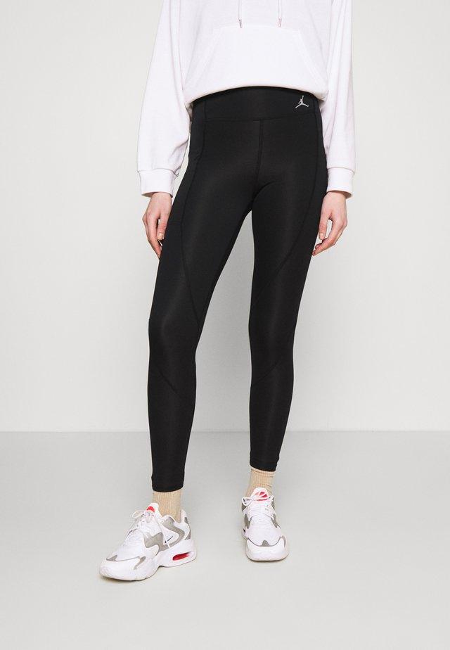 ESSENTIAL - Leggings - Trousers - black/white