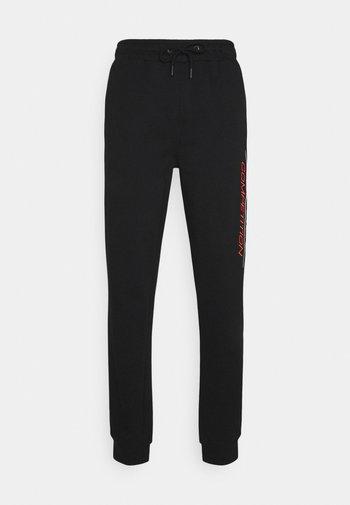 FIN - Tracksuit bottoms - black
