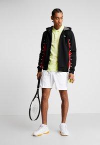 Lacoste Sport - veste en sweat zippée - black/corrida/pitch chine - 1