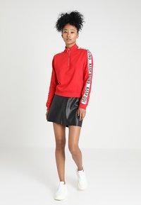 Vero Moda - VMYOURS BUTTER SHORT SKIRT - Mini skirts  - black - 1