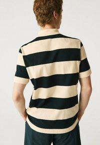 Lacoste - Polo shirt - beige / vert fonce - 1