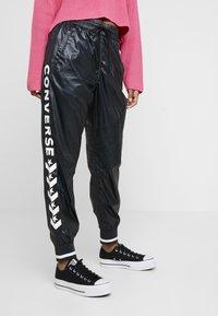 Converse - VOLTAGE JOGGERS - Trousers - black - 0