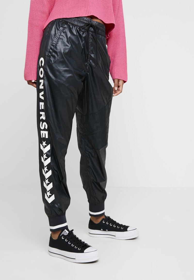 Converse - VOLTAGE JOGGERS - Trousers - black
