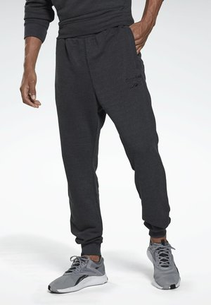 TRAINING ESSENTIALS MÉLANGE JOGGERS - Tracksuit bottoms - black