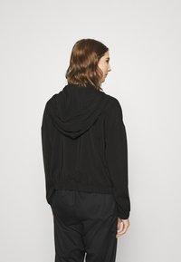 Vero Moda - VMCOCO HOODIE - Summer jacket - black - 2