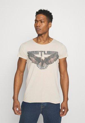 RESTLESS WREN - T-shirt med print - vintage light sand