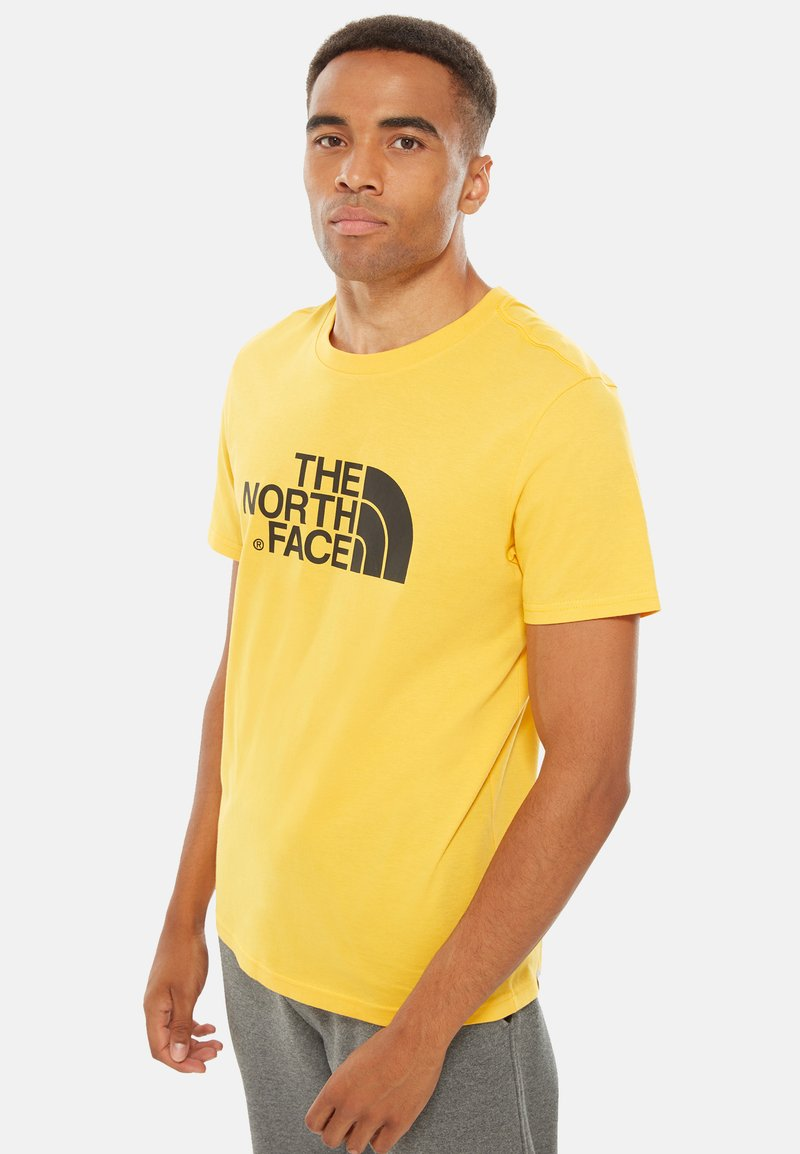 The North Face - M S/S EASY TEE - EU - T-shirt med print - mottled yellow