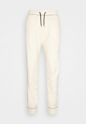 CONTRAST STITCH JOGGER UNISEX - Tracksuit bottoms - off white