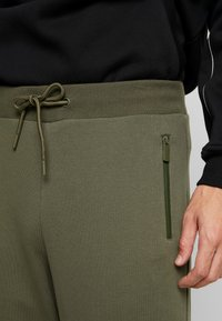 Urban Classics - MILITARY - Tracksuit bottoms - olive - 3