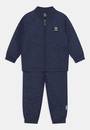 SOBI THERMO SET UNISEX - Rain trousers - dark blue