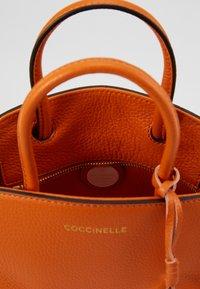 Coccinelle - CONCRETE HANDBAG - Handbag - ginger - 2
