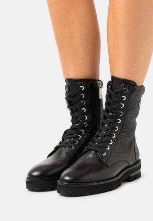 AVA  - Platform ankle boots - black