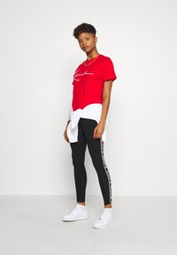 Karl Kani - TAPE TIGHT  - Leggings - Trousers - black - 1