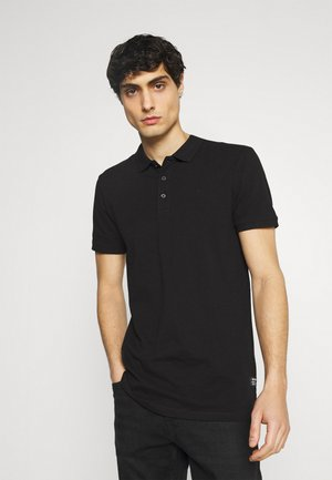 WITH CHEST ARTWORK - Polo shirt - black