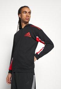 adidas Performance - HOODIE - Zip-up hoodie - black/red - 3