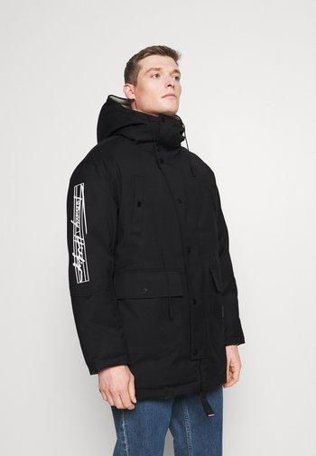 SLEEVE LOGO REVERSIBLEPARKA - Zimní kabát - black