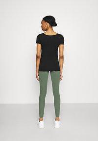 Lindex - MOM LENA - Legginsy - dusty green - 2