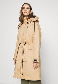 Calvin Klein Jeans - LONG UTILITY HOODED  - Winter coat - irish cream - 4