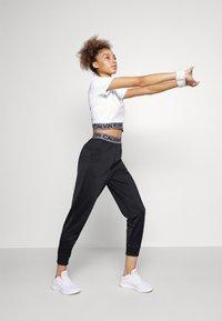 Calvin Klein Performance - PANT - Pantalon de survêtement - black - 1