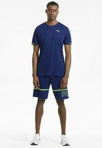 Puma - GRAPHIC  - Print T-shirt - elektro blue - 1