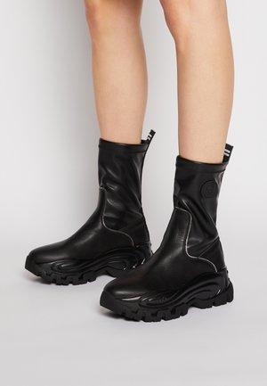 WAVE 16 - Platform ankle boots - black