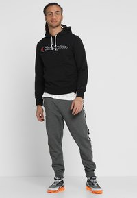 Champion - HOODED  - Hoodie - black - 1