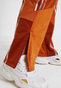 adidas Originals - DANIELLE CATHARI JOGGERS - Trousers - fox red - 4