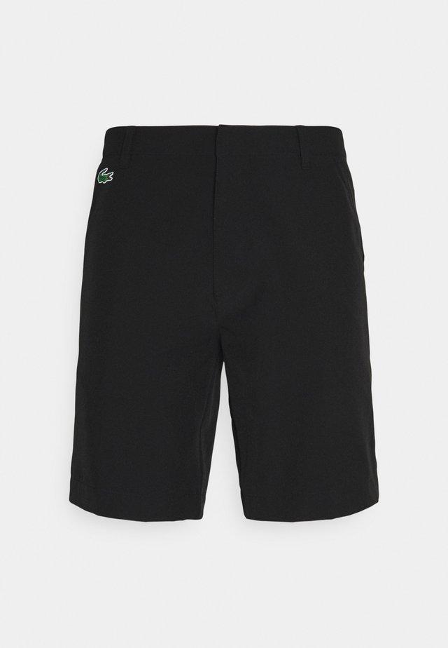 GOLF CHINO - Pantaloncini sportivi - black