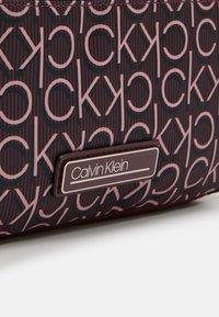 Calvin Klein - CROSSBODY - Skulderveske - purple - 4