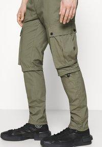 Topman - TECH BUNGEE - Cargo trousers - khaki - 3