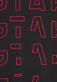 G-Star - EMBRO GRADIENT GRAPHIC LASH - Print T-shirt - black - 5