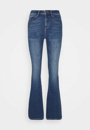 TARA MACAU - Flared Jeans - denim blue