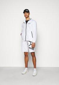 EA7 Emporio Armani - Shorts - white/black - 1