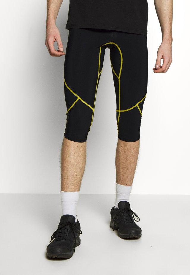 NUCLEUS - Pantalón 3/4 de deporte - black/yellow