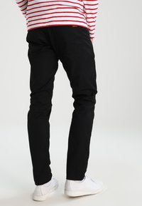 Carhartt WIP - VICIOUS PANT LAMAR - Trousers - black rinsed - 2