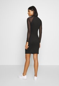 Puma - BODYCON DRESS - Vestido de tubo - black - 2