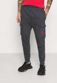 Nike Sportswear - COURT PANT - Tracksuit bottoms - anthracite - 0