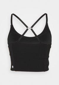 Cotton On Body - STRIKE A POSE YOGA VESTLETTE - Light support sports bra - black - 2