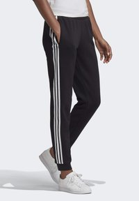 adidas Originals - SLIM CUFFED JOGGERS - Tracksuit bottoms - black - 3