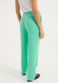 WE Fashion - Trousers - bright green - 2