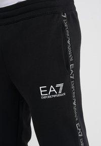 EA7 Emporio Armani - TROUSER - Tracksuit bottoms - black - 4