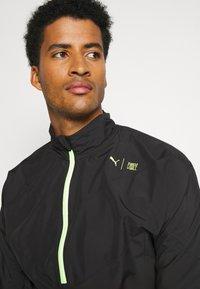 Puma - TRAIN FIRST MILE XTREME JACKET - Training jacket - black - 3