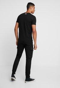 Antony Morato - PANT ON BOTTOM LEGS - Cargo trousers - black - 2