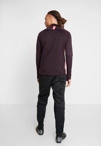 Nike Performance - ACADEMY PANT WINTERIZED - Pantalon de survêtement - black/silver - 2