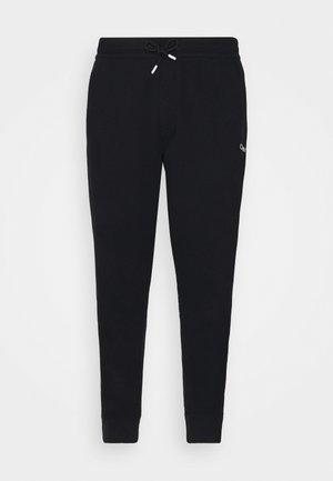 ESSENTIAL TAPE PANT - Verryttelyhousut - black